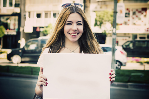 Young woman holding a poster